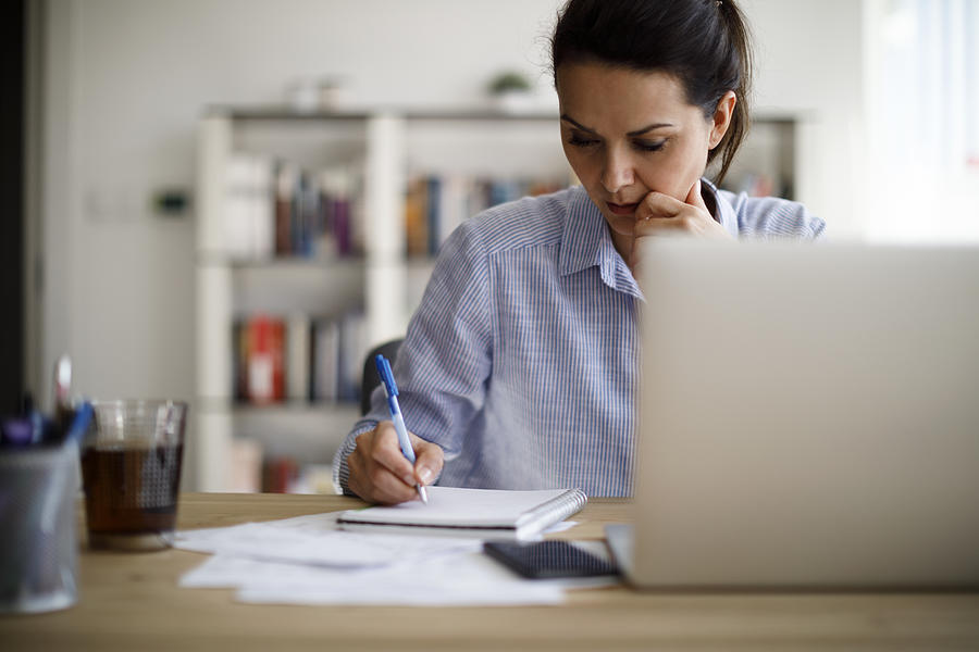 Mature woman working from home Photograph by Damircudic