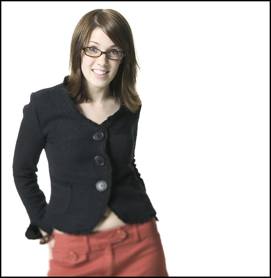 Medium Shot Of A Young Adult Female In A Black Shirt And Glasses As She Smiles Photograph by Photodisc