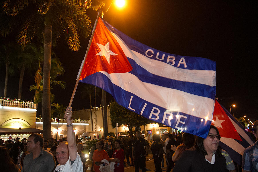 Miami Residents Celebrate The Death Of Fidel Castro Photograph by John Parra