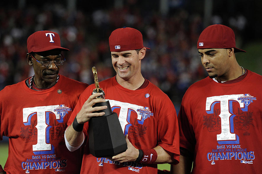 Michael Young, Nelson Cruz, and Ron Washington Photograph by Harry How
