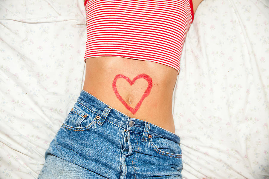 Midsection of woman with heart drawing on stomach Photograph by Shelbyduncan