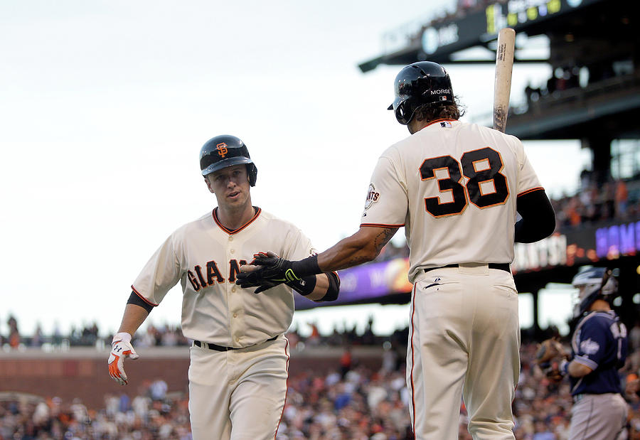Mike Morse And Buster Posey Photograph by Ezra Shaw