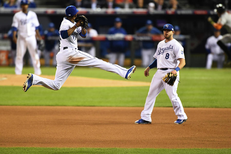 Mike Moustakas and Alcides Escobar Photograph by Rob Tringali