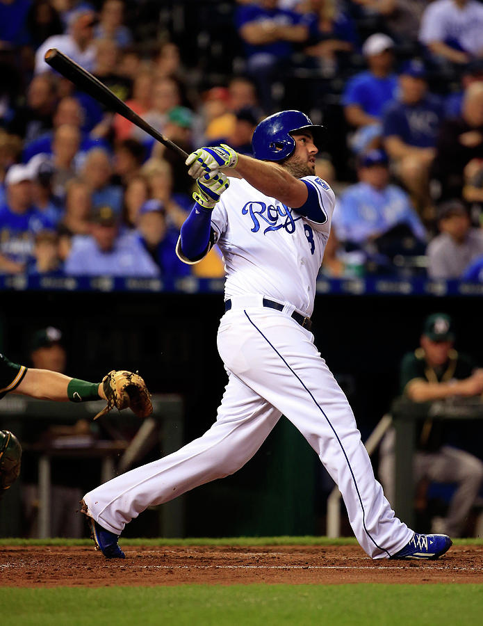 Mike Moustakas Photograph by Jamie Squire