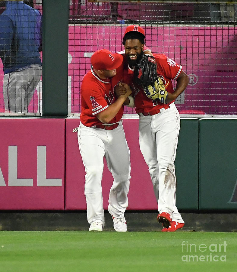 Mike Trout And Brian Goodwin Photograph by Jayne Kamin-oncea
