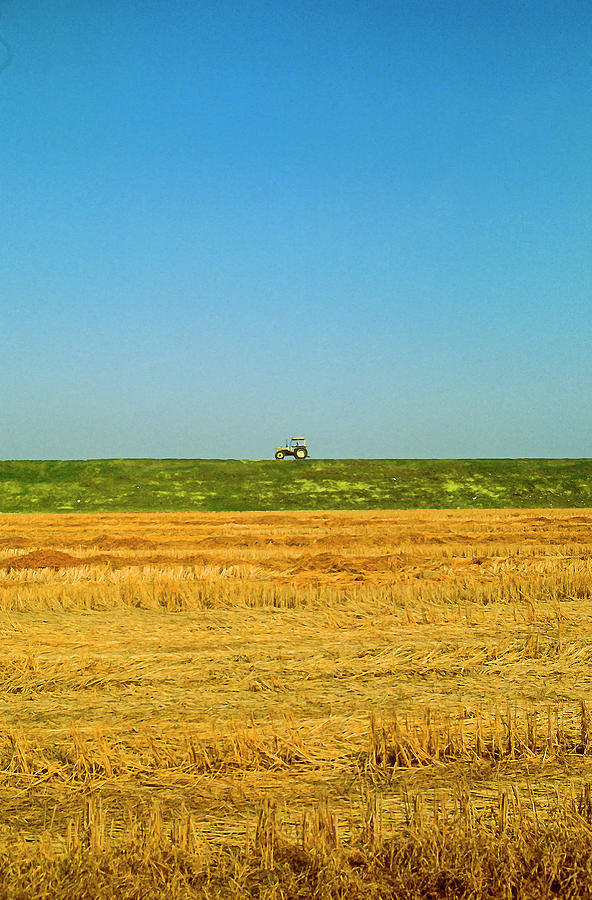 Minimal landscape with tractor by Roberto Pagani