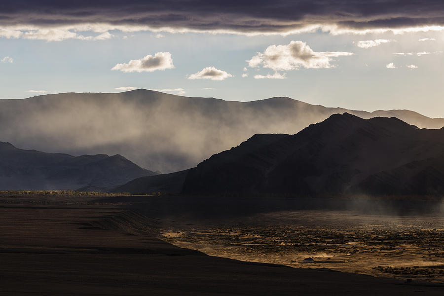 Mist rising from hills in desert landscape Photograph by Jeremy Woodhouse