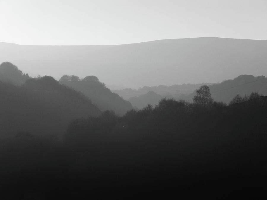 misty grey mountains by Philip Openshaw