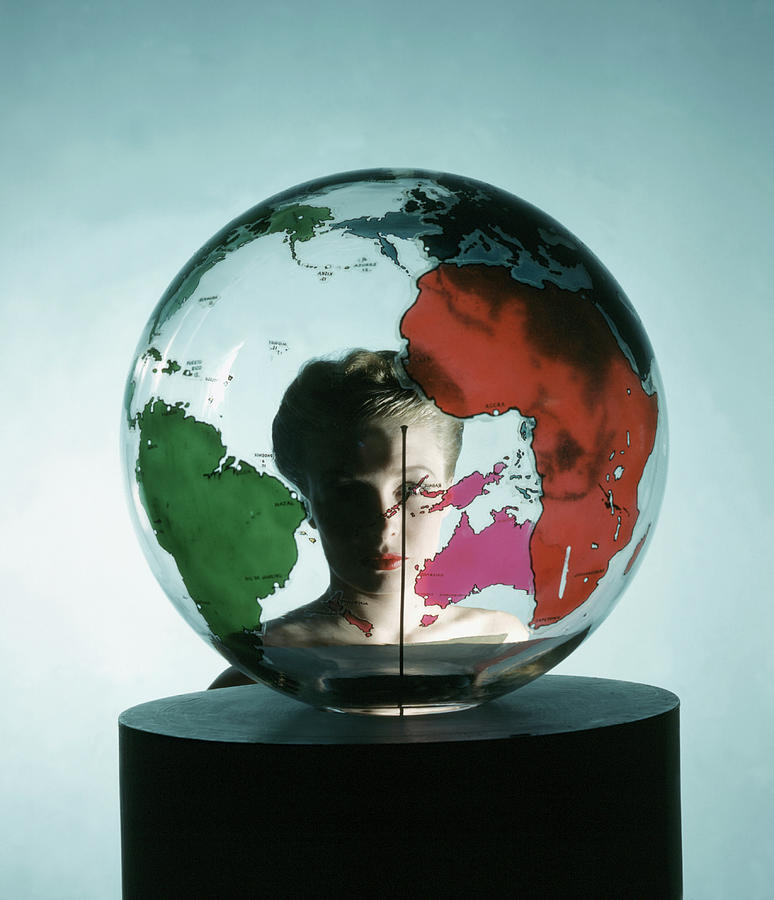 Model Behing Transparent Globe Photograph by John Rawlings