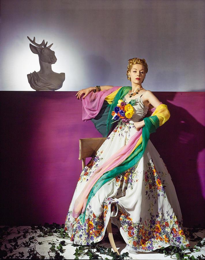 Model Helen Bennett in Bright Floral Dress Beside Bust  Photograph by Horst P Horst