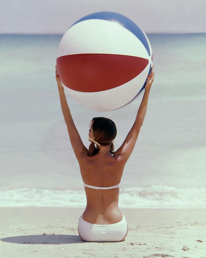 Model Holding Beach Ball Overhead Photograph by Lionel Kazan
