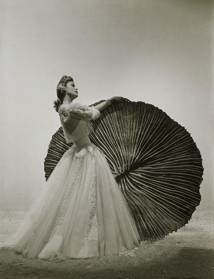 Model In Chanel Dress With Pleated Prop Photograph by Andre Durst