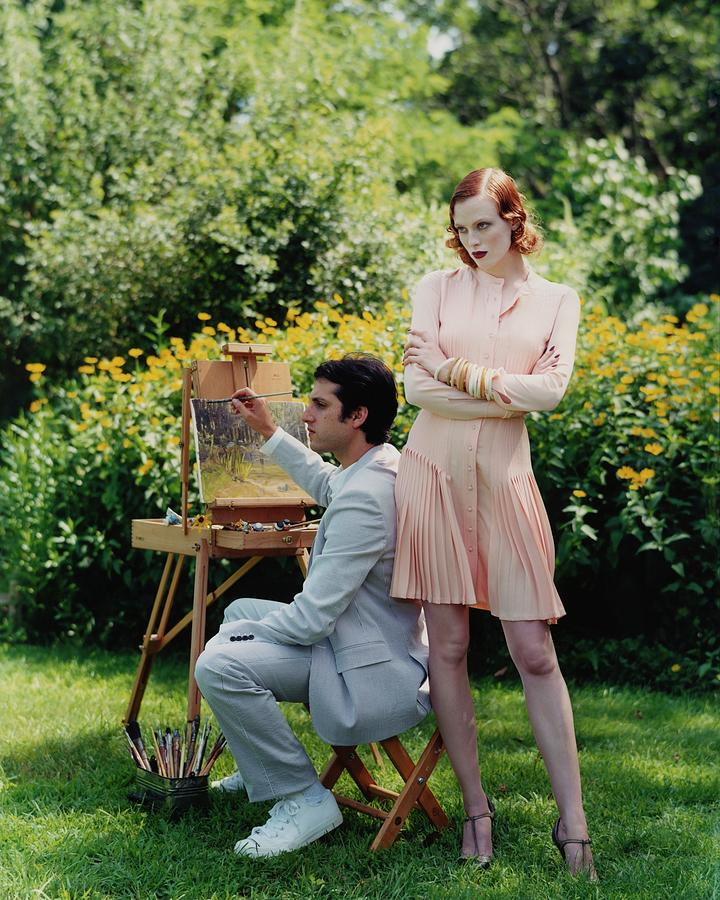 Model Karen Elson With Man Painting Outdoors Photograph by Arthur Elgort