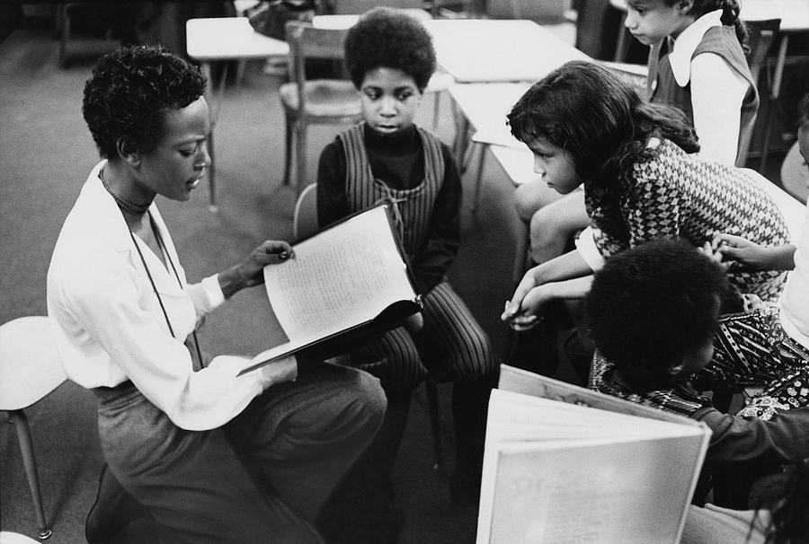 Model Naomi Sims Reading Her Childrens Story Photograph by Berry Berenson