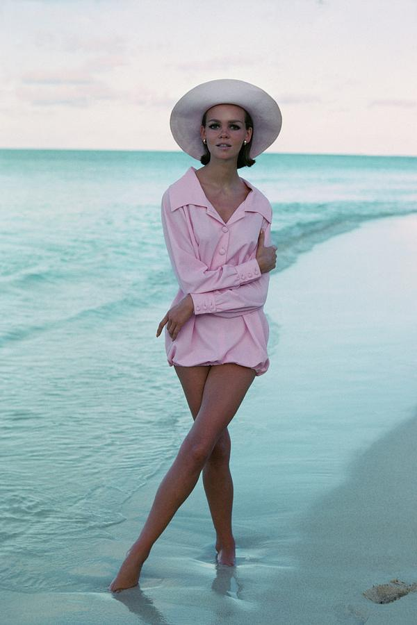 Model on a Beach In a Pink Shirt and Straw Hat Photograph by Francesco Scavullo