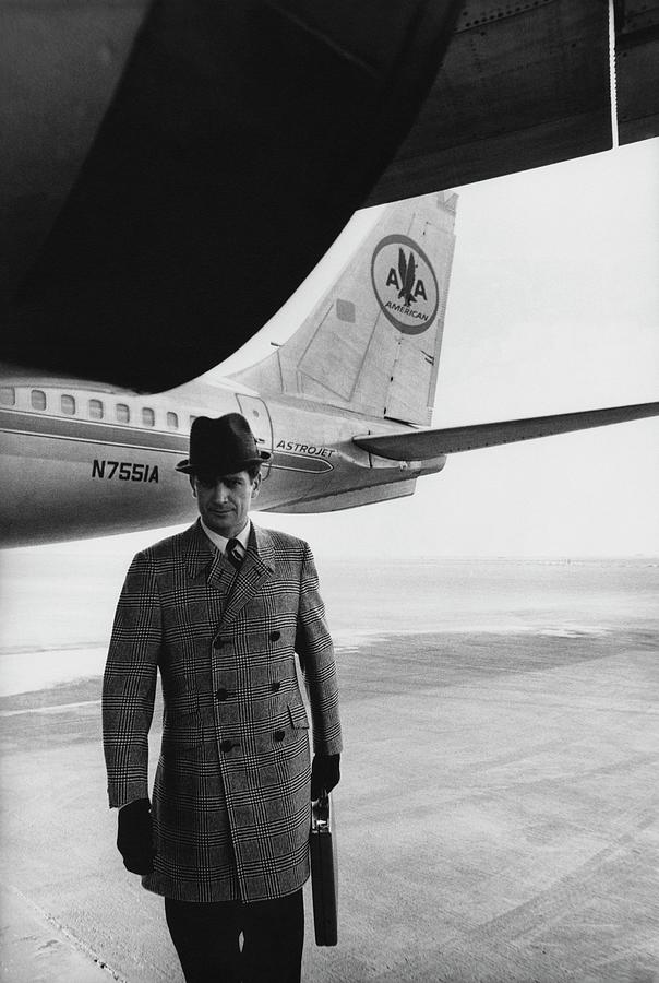 Model on Tarmac With Airplane Photograph by Zachary Freyman