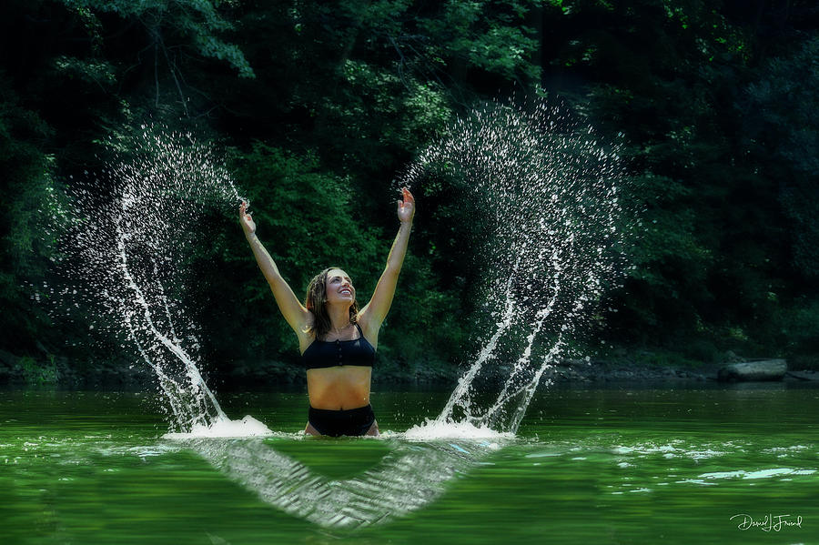 Model Splashing Water In The Lake Making Heart Design Photograph