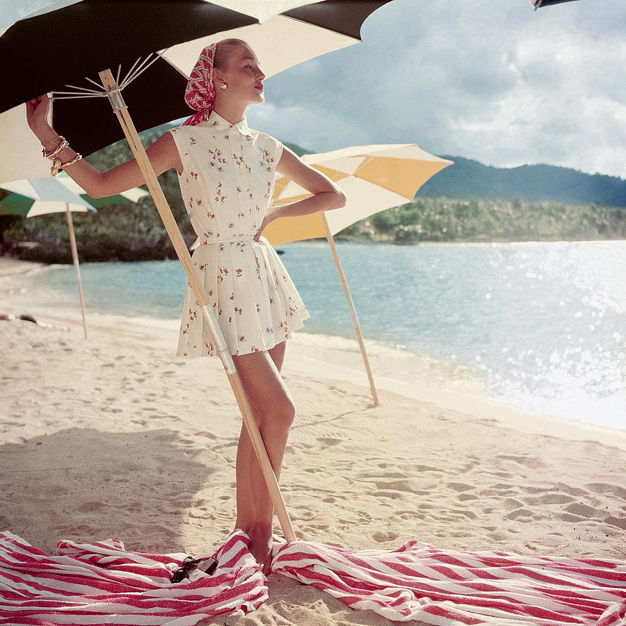 Model Standing Under a Beach Umbrella Photograph by Roger Prigent