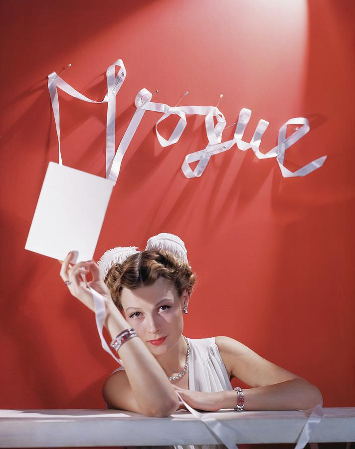 Model with White Ribbon and Card Photograph by Horst P Horst
