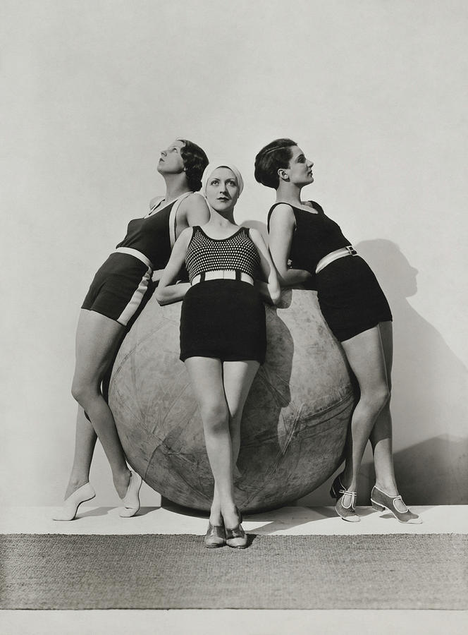 Models Around A Michelin Push-Ball Photograph by George Hoyningen-Huene