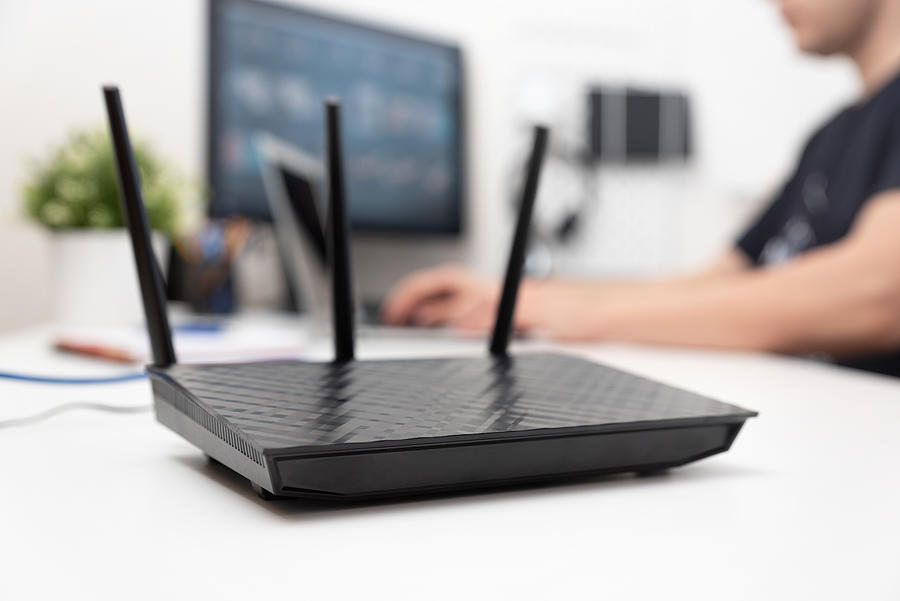 Modern dual band wireless router Photograph by Simpson33