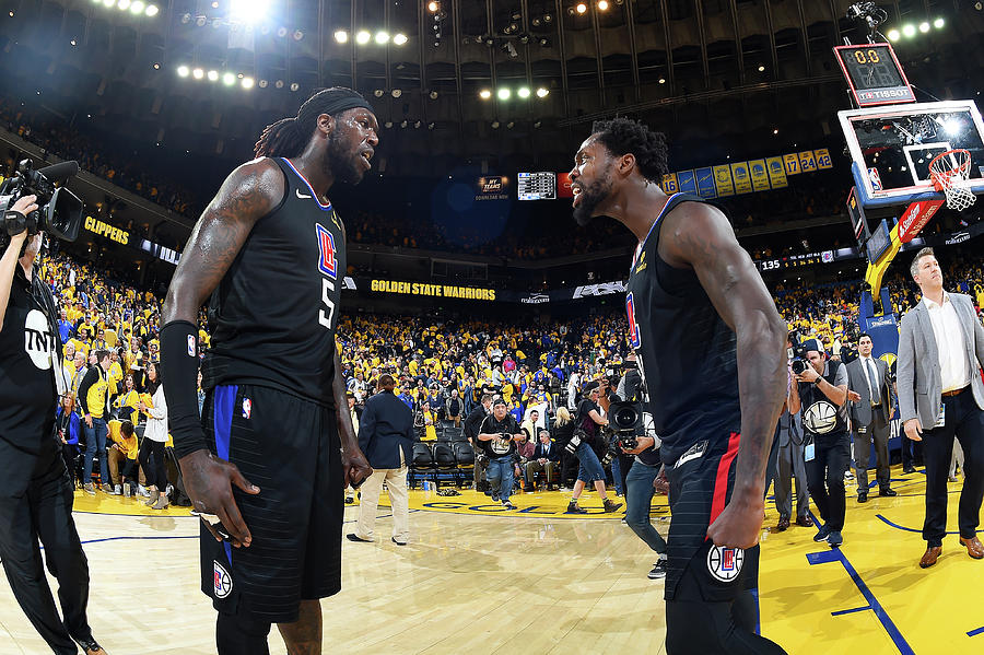 Montrezl Harrell and Patrick Beverley Photograph by Andrew D. Bernstein