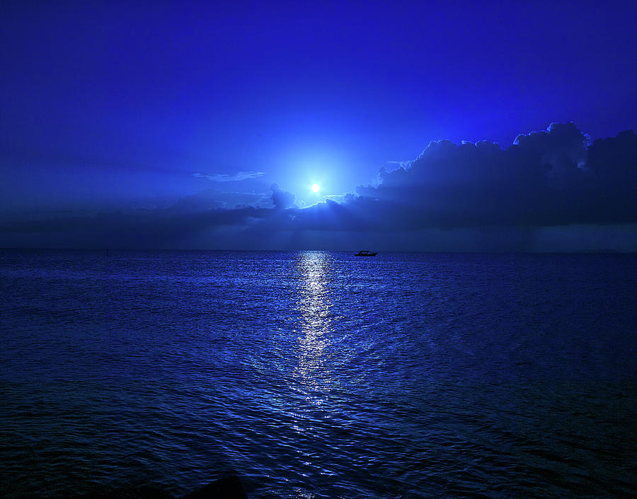 Moonset over the ocean by Trinidad Dreamscape