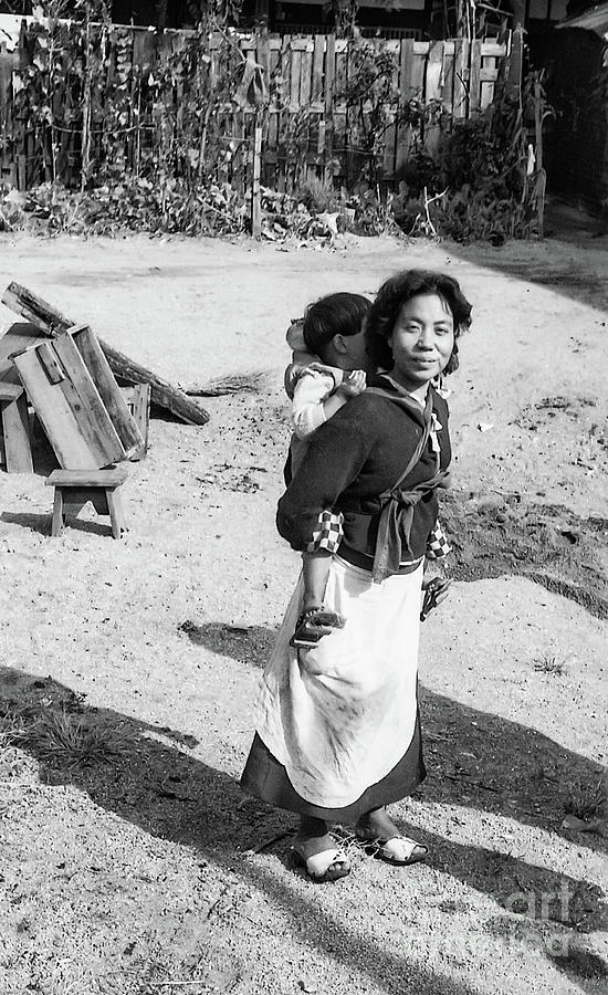 Mother And Infant In The Korean War Photograph