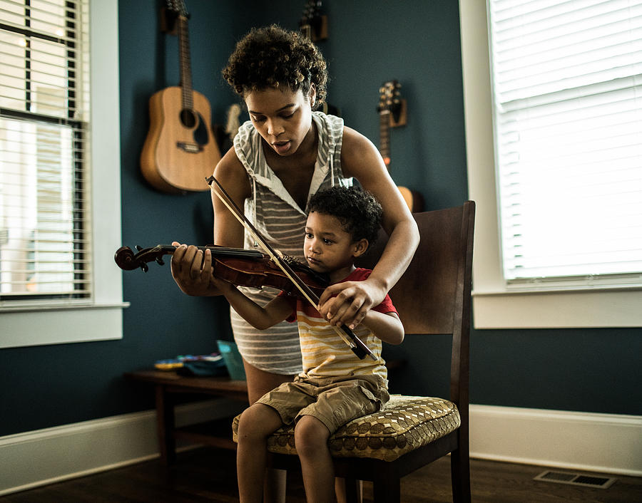 Mother helping young boy (3 yrs) practice violin Photograph by MoMo Productions