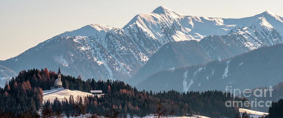 Mountain landscape, picturesque mountain church in the winter morning, large panorama by Luca Lorenzelli