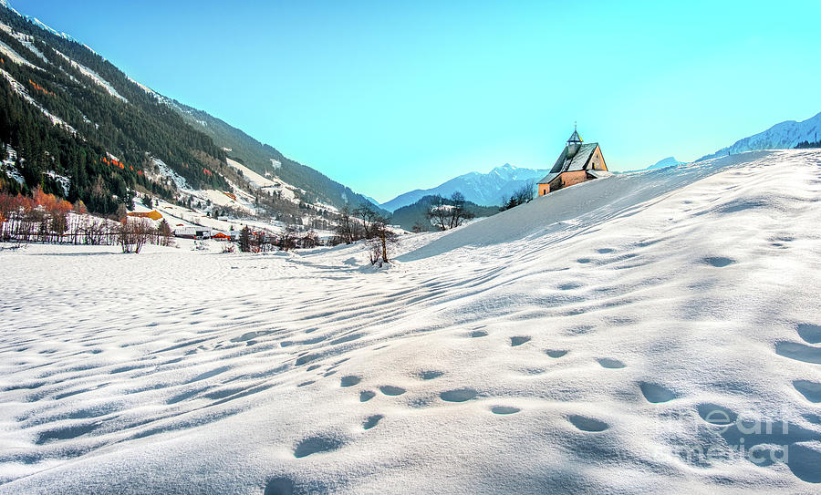 Mountain landscape, picturesque snow footprints in the winter morning panoramic church by Luca Lorenzelli