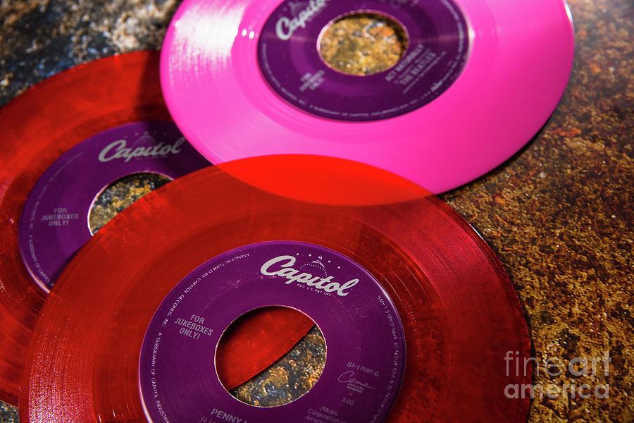 Multi-colored vinyl records  by Joaquin Corbalan