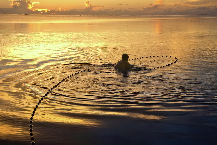 Net Fishing In Tahiti Photograph