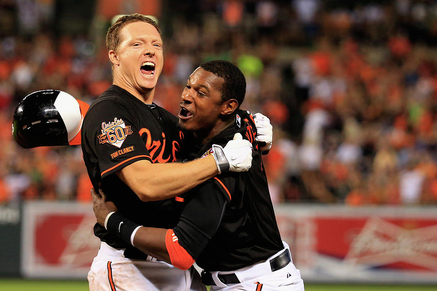 Nick Hundley and Adam Jones Photograph by Rob Carr