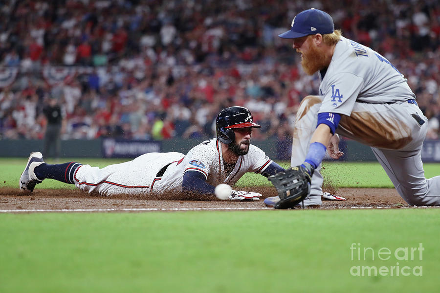 Nick Markakis And Justin Turner Photograph by Rob Carr