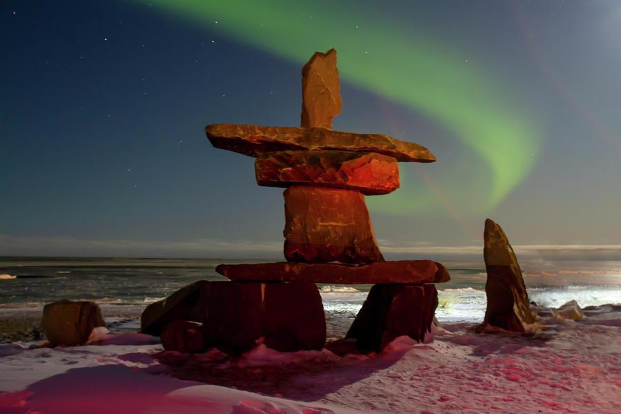 Northern lights and inukshuk on Hudson Bay at night by Karen Foley