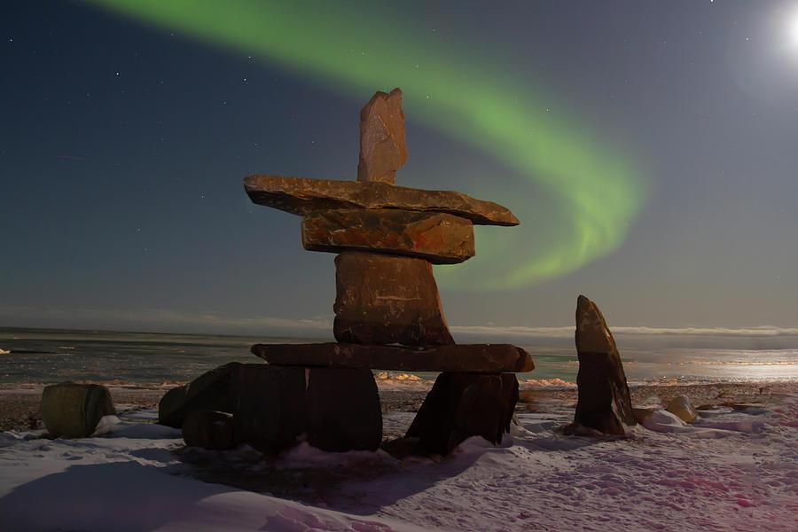 Northern lights and inukshuk on Hudson Bay by Karen Foley