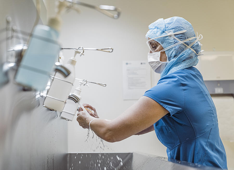 Nurse washing hands to avoid Covid 19 virus. Photograph by Hraun