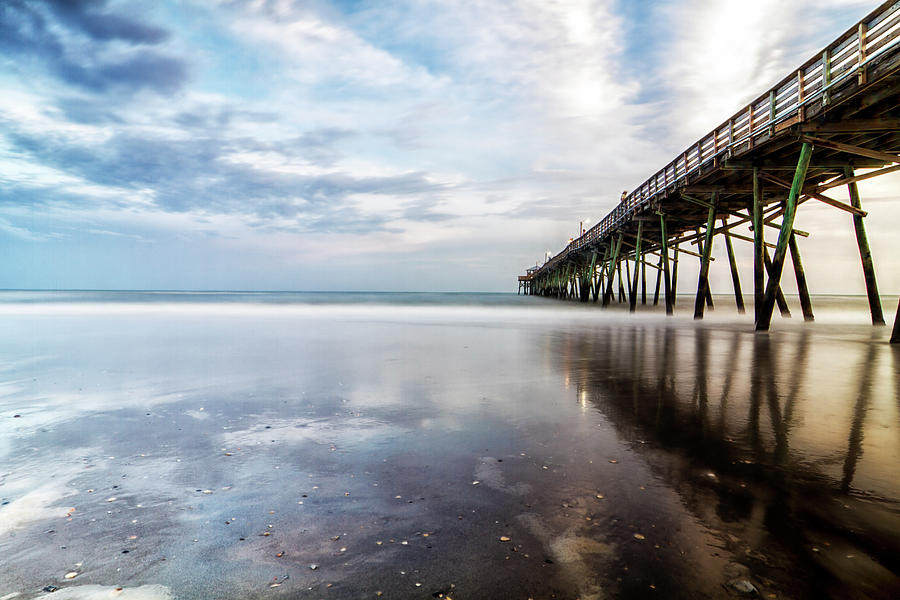 Oceanna Pier With Blue Skies And Dark Clouds Reflected Photograph