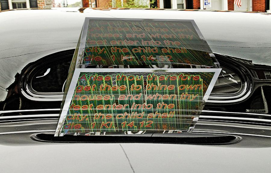 Old car rear window with text as a box by Karl Rose