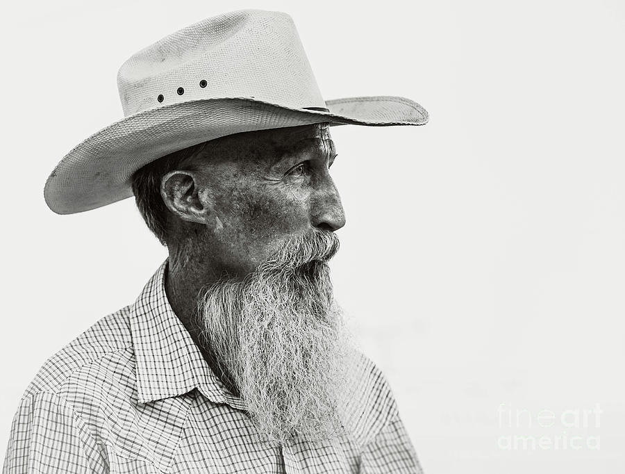 Old Cowboy In Black And White Photograph