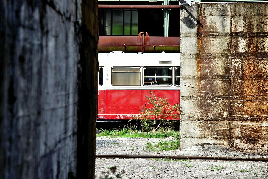 Old Deserted Train Between Buildings Photograph