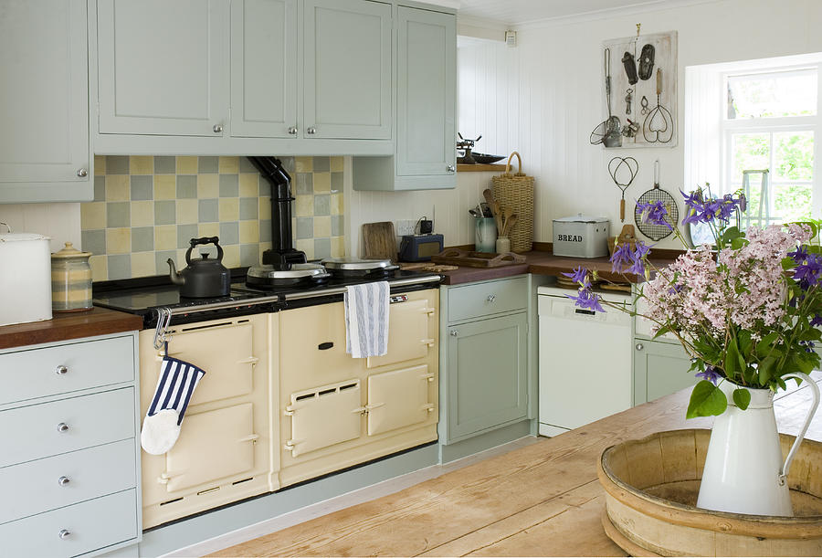 Old-fashioned stove in kitchen Photograph by Kim Sayer