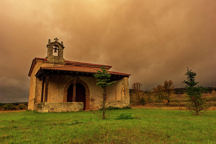 Old hermitage under a cloudy sky in Soria by Vicen Photography