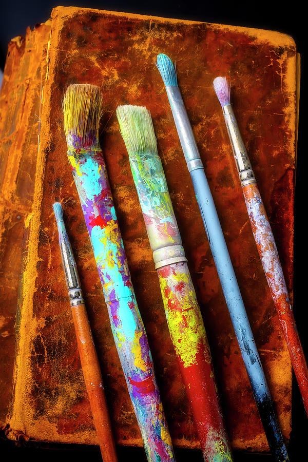 Old Paint Brushes And Worn Books by Garry Gay