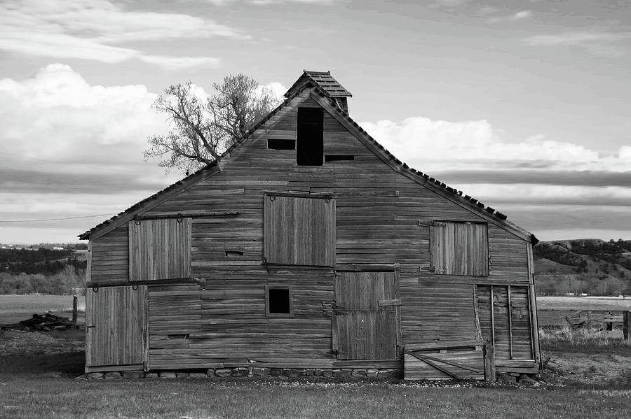 Old Wooden Barn In Black And White Photograph