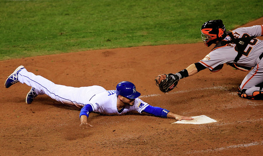 Omar Infante and Buster Posey Photograph by Jamie Squire