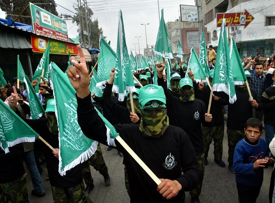 Palestinians Hold Rally To Mark 16th Anniversary Of Hamas Photograph by Abid Katib