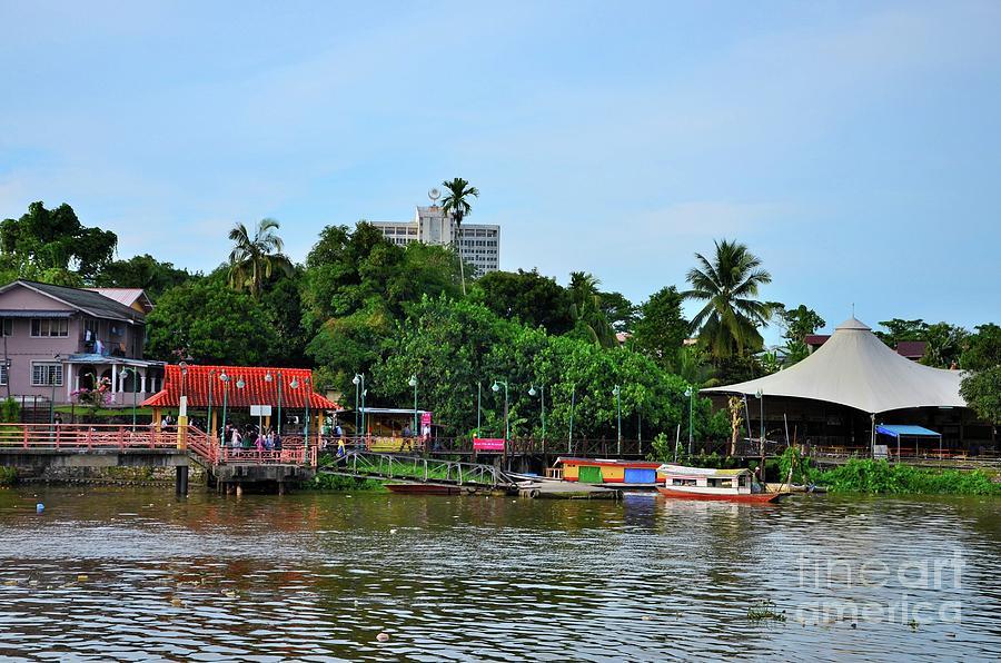 Passengers alight from boat ferry at north Sarawak River Jetty Kuching Malaysia by Imran Ahmed