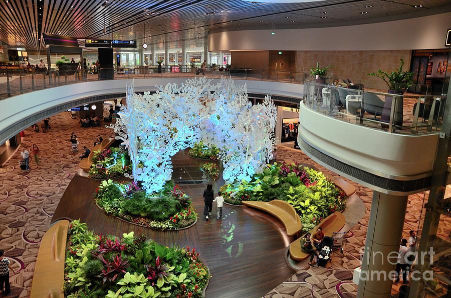 Passengers Move Around A Green Garden Relaxing Area Inside Changi Airport Terminal Singapore Photograph